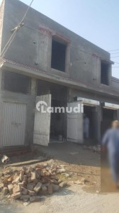 7 Marla House With 7 Shops Available For Sale