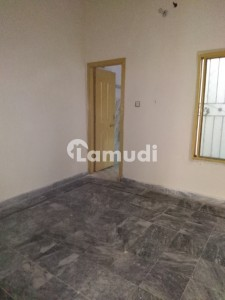 A Spacious 1125  Square Feet House In Millat Colony