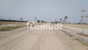 A Stunning Residential Plot Is Up For Grabs In Ferozepur Road Madni Gardens Housing Scheme