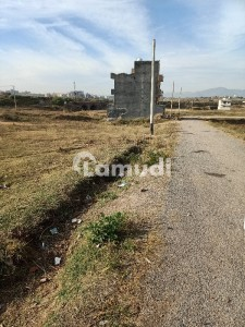 4 Marla plot for sale with extra land and back open