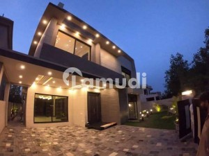 1 Kanal Most Fabulous Architectural Design Facing Park Full Basement having Home Theater Solid Construction In phase 5 Near Sports Complex DHA Lahore Cantt