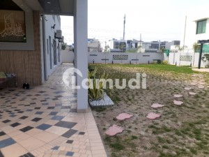 2 Kanal Brand New 5 beds Bungalow with Kanal Beautiful Garden for urgent Sale