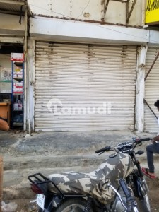 10 X 15 Shop Available With 15 K Rental Income Near To Main University Road In Four Square Block 4 Gulistan-e-jauhar!